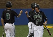 Free State's Joe Dineen (15) celebrates a run scored with teammate Trent Johnson (8) during their game against Warrensburg, Mo., in the 2012 River City Baseball Festival on Thursday, April 19, 2012, at Hoglund Ballpark on the campus of Kansas University.
