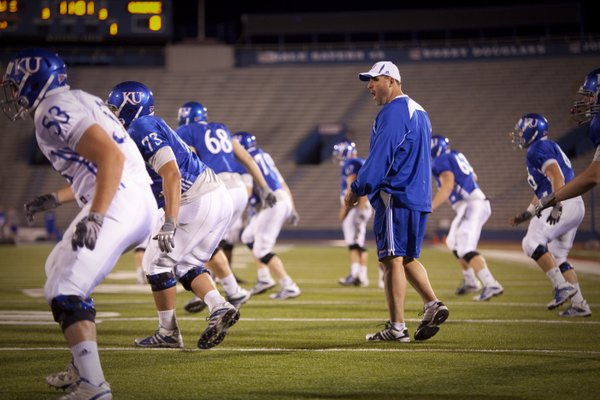 Offensive line coach Tim Grunhard works with his players during a morning practice on Thursday, April 19, 2012 at Memorial Stadium.