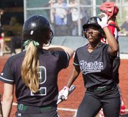 Free State's Alex Hill (2) congratulates A'Liyah Rogers following Rogers' run during the Firebirds' game against Lawrence High on Saturday, April 21, 2012, at FSHS.