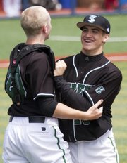 Free State catcher Lee McMahon, left, celebrates with pitcher Sam Hearnen following the Firebirds' victory over Branson (Mo.) Saturday, April 21, 2012, at Hoglund Ballpark.