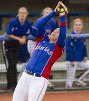 Kansas third baseman Chanin Naudin grabs a pop fly during KU's game against Iowa State Sunday, April 22, 2012 at Arrocha Ballpark.