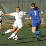 Free State junior Chelsea Casady works the ball against Gardner-Edgerton&#39;s Taylor Rayburn on Monday, April 23, 2012, at Free State