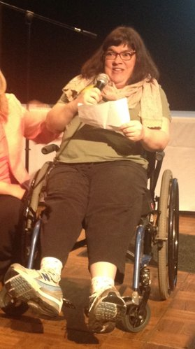 Lorraine Cannistra, who has cerebral palsy, talks about the services that she receives at Bert Nash Community Mental Health Center during its annual Pioneer Celebration on Monday, April 23, 2012, at Maceli's in downtown Lawrence.
