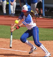 Kansas' Elsa Moyer slaps a single in the Jayhawks' first game of a doubleheader with UMKC on Wednesday, April 25, 2012, at Arrocha Ballpark.