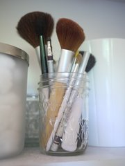 A mason jar can organize makeup brushes or other items in your medicine cabinet.