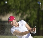 Kansas University golfer Meghan Potee takes a turn from a sand trap during a practice round for the Big 12 Championships on Thursday, April 26, 2012 at Lawrence Country Club.