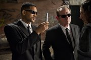 "In this film image released by Sony, Will Smith, left, and Tommy Lee Jones are shown in a scene from ""Men in Black 3."""