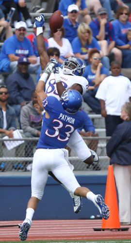 Kansas cornerback Tyler Patmon breaks up a pass to receiver Chris Omigie during the first half of the Spring Game on Saturday, April 28, 2012 at Kivisto Field.