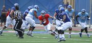 Kansas redshirt quarterback Jake Heaps takes off on a run during the first half of the Spring Game on Saturday, April 28, 2012 at Kivisto Field.