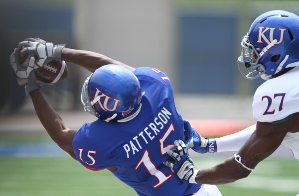 Kansas receiver Daymond Patterson is pushed out of bounds for an incomplete pass by safety Victor Simmons during the first half of the Spring Game on Saturday, April 28, 2012 at Kivisto Field.
