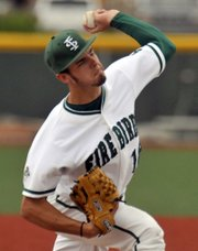 Free State pitcher J.D.Prochaska fires another throw as Free State hosted Olathe North on Tuesday, May 1, 2012, at FSHS.