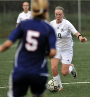 Free State's Madeline Caywood pushes the ball down field as the Firebirds hosted Olathe East on Tuesday, May 1, 2012, at FSHS.