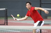 Lawrence High senior Matt Grom comes around on a return during a singles match against Mill Valley sophomore Eric Howes on Wednesday, May 2, 2012 at LHS.