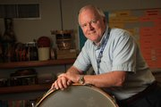 John Bowman, has taught music to elementary school students in Lawrence for 20 years.