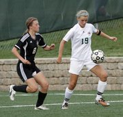 Free State junior Abbey Casady, right, controls the ball with her knee against the Lions' Addison Campbell on Thursday May 3, 2012, at FSHS.