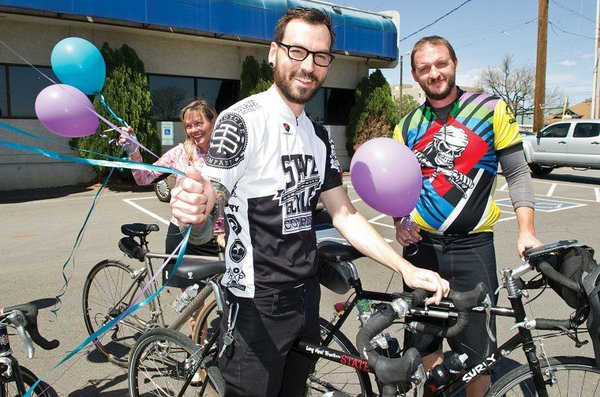 Zachary Chipps, left, and Thomas Brown, both of Scottsdale, Ariz., are bicycling across the country to raise awareness about suicide prevention. They both lost an older brother to suicide. Their journey began March 1, 2012, at the San Francisco Golden Gate Bridge and will end Sept. 30, 2012, in Wappengers Falls, N.Y. They are pictured during a stop in Colorado. Chipps and Brown stopped in Lawrence in May.