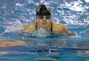 Free State's Katie Kimbrough competes in the 200 yard medley relay during the girl's 2012 Sunflower League Championship preliminaries Friday, May 4, 2012 at the Lawrence Indoor Aquatic Center.