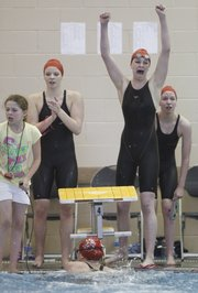 Lawrence High sophomore Annie Odrowski, second from right, gets caught up in the emotion of a come-from-behind second-place finish for the Lions as sophomore anchor Heather Cistola finishes during the Girls 400 Yard Freestyle Relay event of the Sunflower League Swimming and Diving Championships on Saturday, May 5, 2012 at Free State High School. Pictured at left is LHS sophomore Gretchen Frick, and at right is junior Miranda Rohn. 