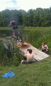 What better way to celebrate Stop Day than by zipping off a flaming ramp on your bike into Potter Lake?