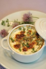 Herbed Baked Eggs are an easy but elegant dish to make for mom on Mother's Day. Fresh herbs add garden flavor.