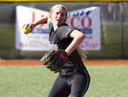 Free State's Samantha O'Brien throws to first during Lawrence High's game against Free State Monday, May 7, 2012 at LHS.