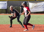 Lawrence High's Lauren Byrn leads off from second while Free State's Samatha O'Brien watches the pitch during Lawrence High's game against Free State Monday, May 7, 2012 at LHS.