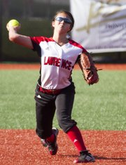 Lawrence High's Marly Carmona throws to first during Lawrence High's game against Free State Monday, May 7, 2012 at LHS.