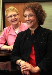 Rogene Anderson, left, and Cathy Crispino, longtime music teachers at Lawrence High School, are retiring at the end of the school year. Crispino has been the choir director for the last 15 years, and Anderson has been the choir's accompanist for the last 23 years.
