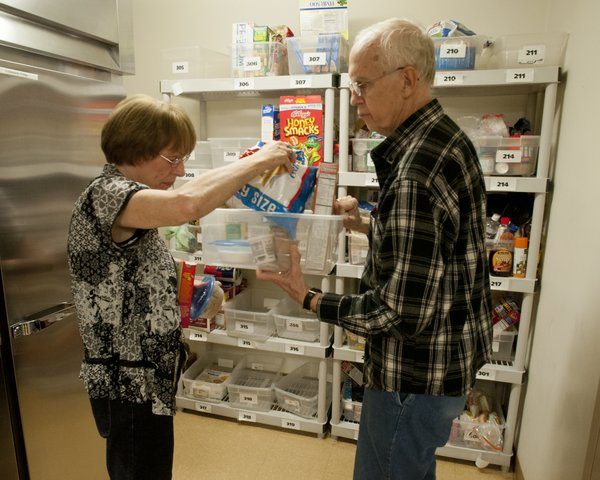 Nancy and Phil Gosling, of Goff, go through the grocery supplies that they are keeping in the kitchen area at the American Cancer Society's Hope Lodge on Thursday, May 3, 2012. Nancy Gosling described Hope Lodge as a godsend because it cut down on driving and costs and it allowed her to focus on Phil's cancer treatments. She said they also enjoy the company of others who are going through cancer.