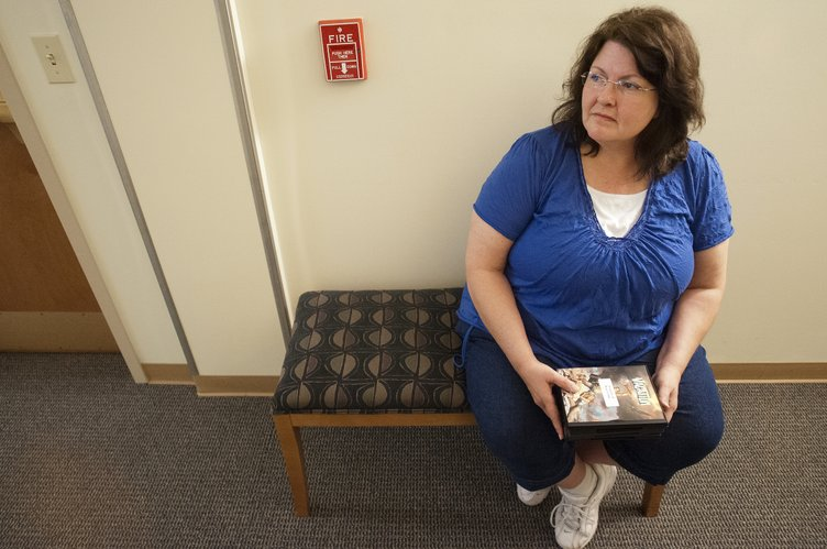 Deborah O'Dell, of Pittsburg, waits in the hallway for the elevator Thursday, May 3, 2012, at the American Cancer Society's Hope Lodge in Kansas City. She was biding time while her 27-year-old son James, who has Non-Hodgkin's lymphoma, slept in their room. He was participating in a clinical trial at Kansas University.