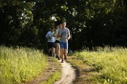 Justin Henning, Lawrence, leads a group of Lawrence Trailhawks runners along the North River Trail on Monday, May 7, 2012.
