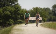 Lawrence residents Matt Salad and Elyse Inferrera ride along the levee trail on Thursday, May 10, 2012, in North Lawrence.