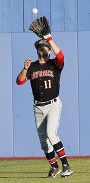 Lawrence High senior center fielder CJ Roush picks a fly ball out of the air against Free State on Thursday, May 10, 2012, at Hoglund Ballpark on the Kansas University campus.