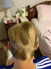 "A photo of the ""crazy haircut"" that landed some Lawrence High School students with both in- and out-of-school suspension."