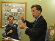 Gov. Sam Brownback on Friday discusses tax policy during a news conference in the Statehouse.