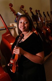 Raven Graves, a graduating Free State High School senior, has excelled in music and hopes to become a teacher. She will be attending Coffeyville Community College on a full scholarship.