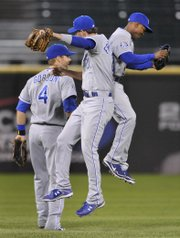 Kansas City outfielders Jarrod Dyson, left, Jeff Francoeur, center, and Alex Gordon celebrate after defeating Chicago. The Royals blanked the White Sox, 5-0, Saturday in Chicago.