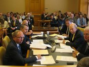House-Senate tax conferees meet Tuesday before a packed room in the Statehouse. 