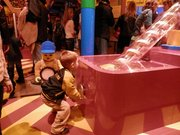 A child learns how LEGO bricks are made in the LEGO Factory at LEGOLAND Discovery Center at Crown Center in Kansas City, Mo.