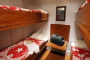 The re-creation of a third class cabin on board the Titanic contains White Star Line bedding. &quot;Titanic: The Artifact Exhibition&quot; will be at Union Station in Kansas City, Mo., through Sept. 3, 2012.