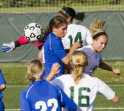 Free State's Margaux Gill (14), Rylee Fuerst (8) and Chelsea Casady (16) battle for the ball against Gardner Edgerton's Molly Porter following a Free State corner kick during Free State's regional soccer match against Gardner-Edgerton Tuesday, May 15, 2012 at FSHS