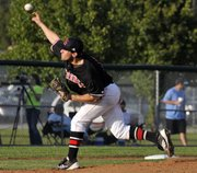 Lawrence High's Troy Willoughby fires a pitch against Olathe Northwest in regional championship action Tuesday, May 15, 2012, at CBAC in Olathe. Willoughby battled through a muscle injury most of the game.