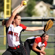Lawrence High pitcher Megan Sumonja fires a pitch against Topeka High in a Class 6A regional semifinal softball game on Tuesday, May 15, 2012, at CBAC in Olathe.