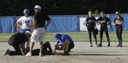 Free State shortstop A'Liyah Rogers is tended to after she was spiked in the leg in the first inning on a play at second base. The Firebirds suffered a 16-3 loss to Washburn Rural in a Class 6A regional championship game Wednesday, May 16, 2012, at Washburn Rural High School.