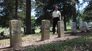 Jim Peters looks over some Civil War graves in Oak Hill Cemetery last week. Peters is the author of the most popular guide book on Arlington Cemetery outside Washington, D.C., which was originally a burial ground for Union veterans of the Civil War.