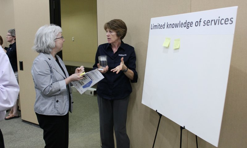 Ann Gabel, left, an employee of Lawrence Memorial Hospital, visits with Kim Ens, director of clinic services at the Lawrence-Dougas County Health Department, during a public health forum Thursday, May 19, 2012, at the Community Health Facility, 200 Maine.