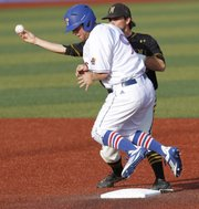 Kansas University&#39;s Tucker Tharp (9) runs into second base on a force out, but breaks up a double-play during the Jayhawks&#39; 1-0 win over Missouri, Thursday, May 17, 2012, at KU in the first of a three-game series.
