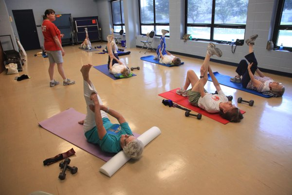 A group of senior citizens works out at Holcom Park Recreation Center, 2700 W. 27th St., as part of the city's Slimnastics program. Using the buddy system or signing up for a class can make it easier to stick with a workout program, says Jo Ellis, recreation instruction supervisor for the cit