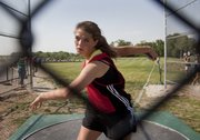 Lawrence High  discus thrower Matia Finley winds up for a throw in the 6A regional track meet Friday, May 18, 2012, at Free State High.