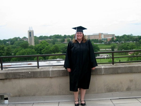 "Jacque Mocnik-Boyd graduated from Kansas University on May 13, 2012, with two bachelor's degrees. She wished her ""other mom"" and stepfather, who both died of cancer, could have been there to see her accomplishment. She participates in Relay For Life to remember them."
